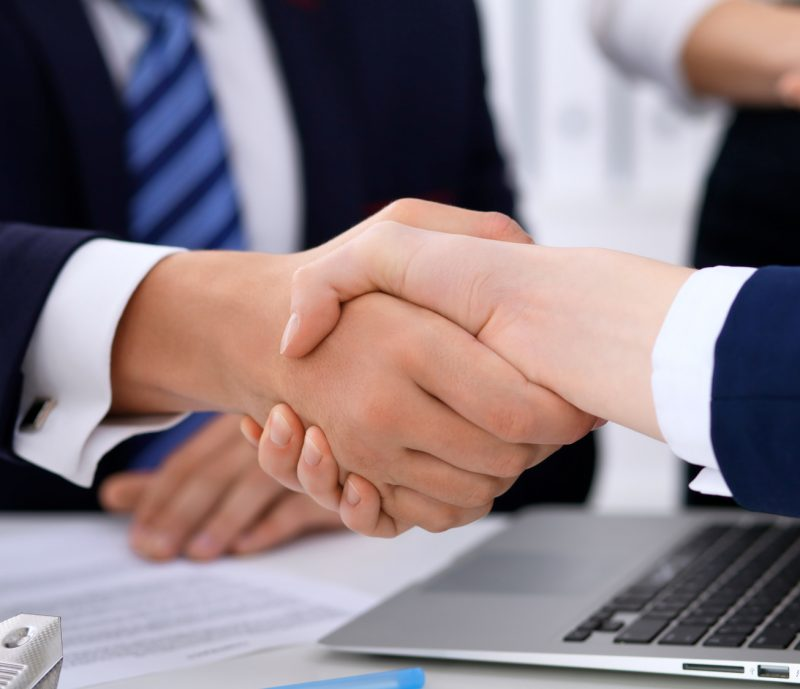 lawyer shakes hands with client