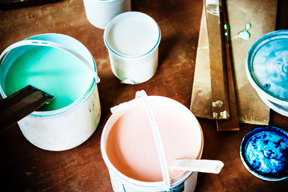paint buckets and stir sticks