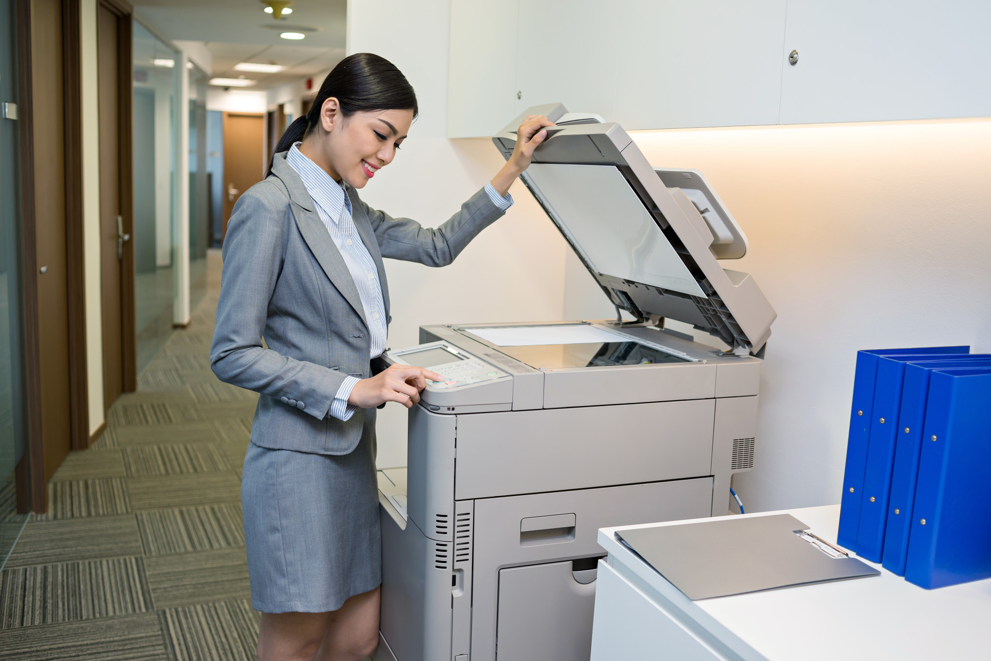 woman with office copy machine
