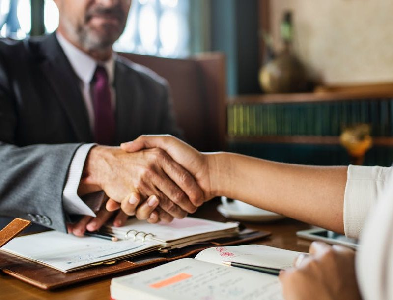 person shaking hand with lawyer