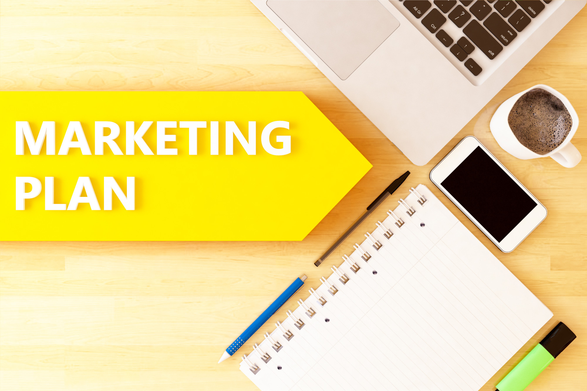 marketing plan text and laptop