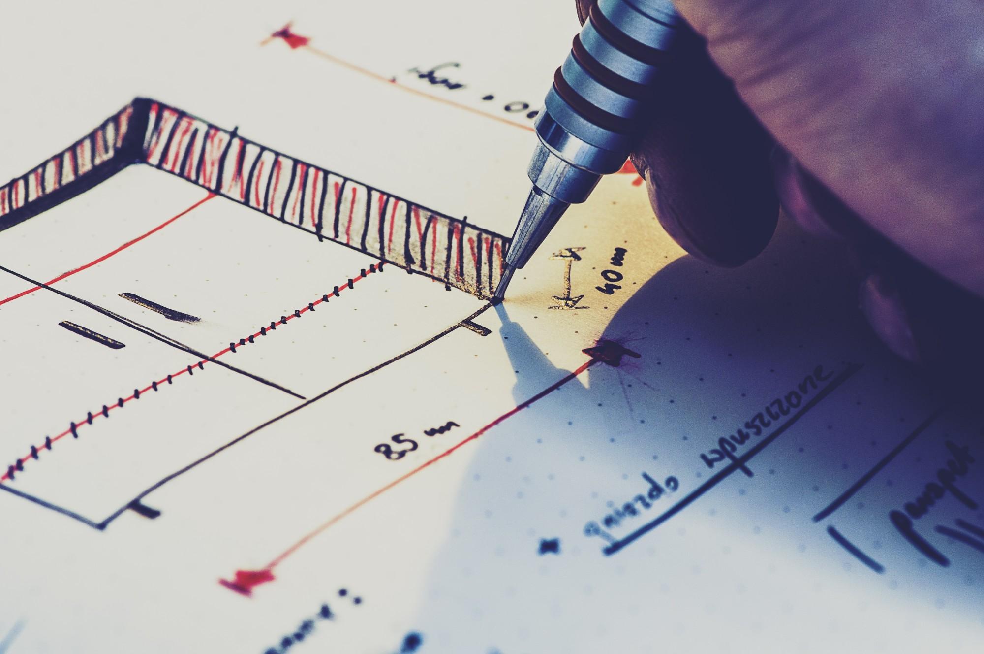 person designing something on paper
