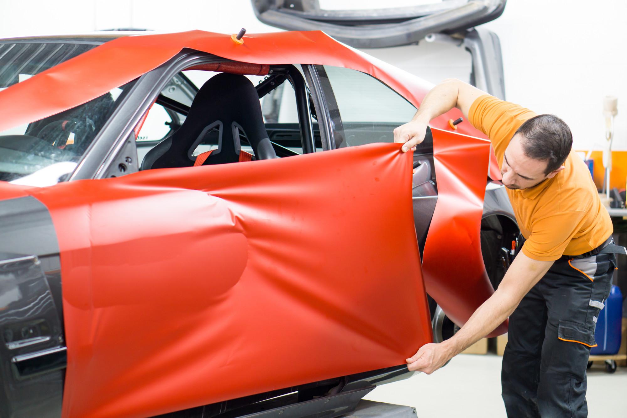 person applying car wrap
