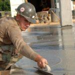 man laying concrete