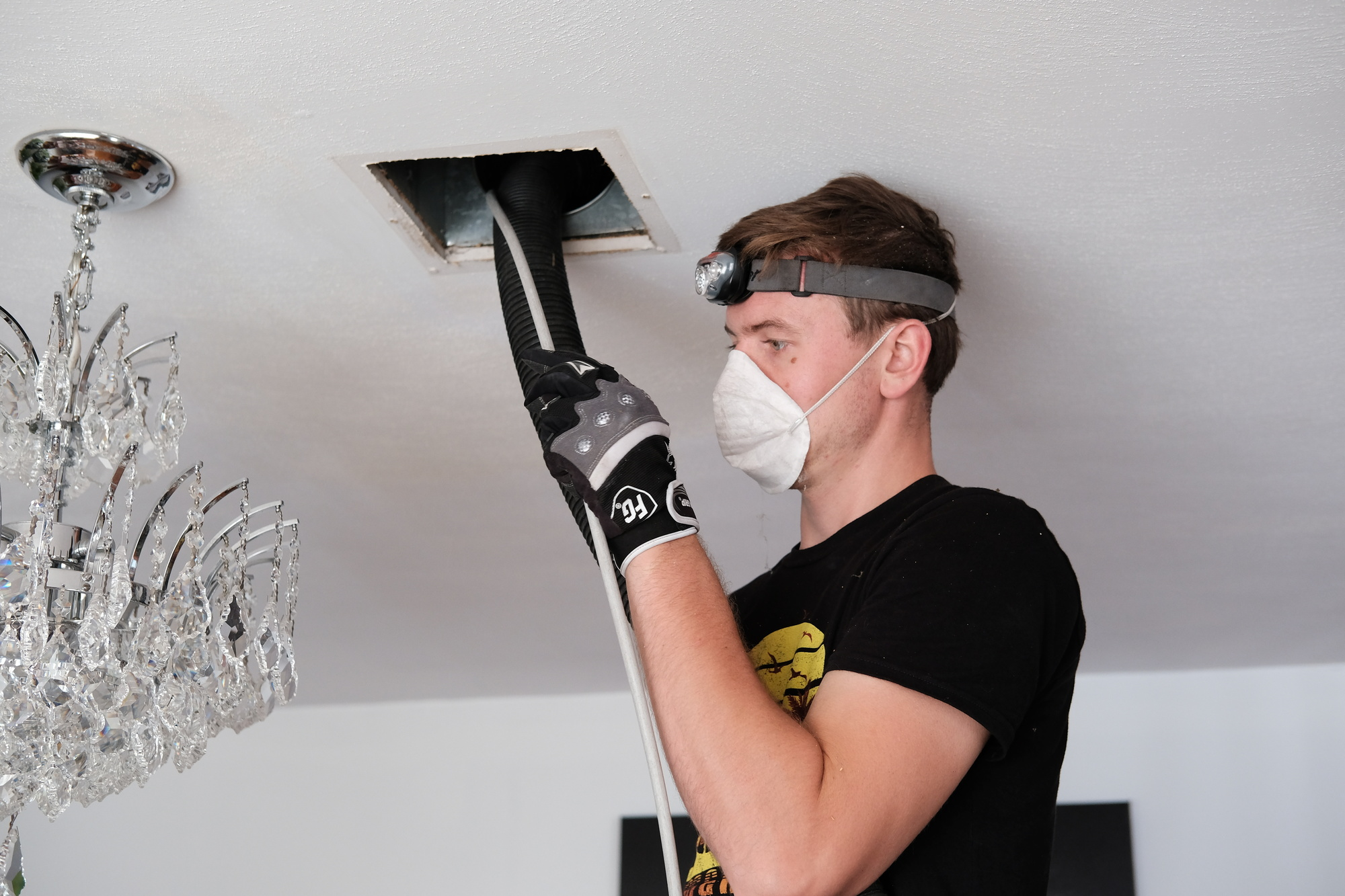 man cleaning air ducts
