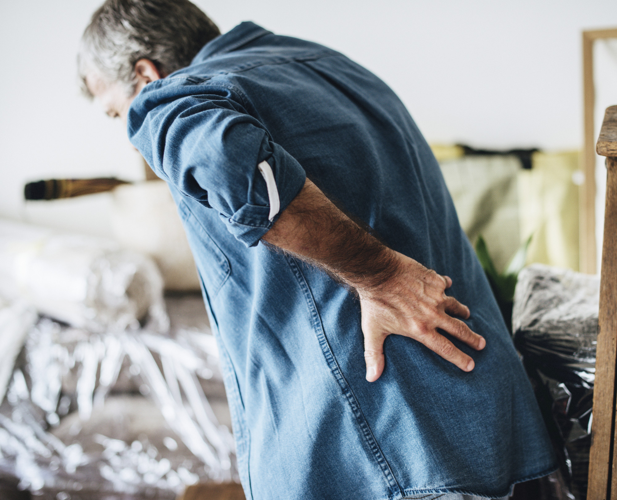 Old Man Experiencing Back Pain