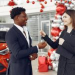 Man Purchasing a Car at a Dealershp